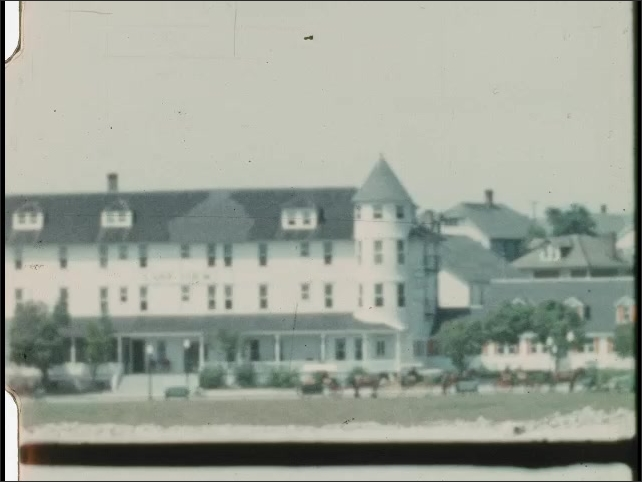 1940s: UNITED STATES: settlement by the sea. Buildings in bay. Sea defence.