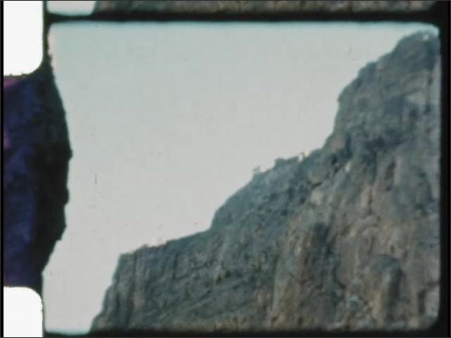 1940s: UNITED STATES: view of ridge from valley. Steep sides of rocky mountain. Cliff face.