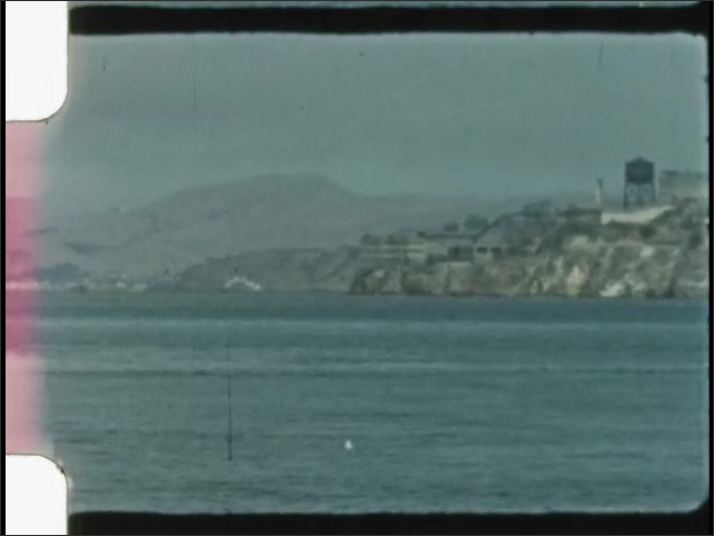1940s: UNITED STATES: Keep Off sign. Birds on sea cliff and headland. Building on island.