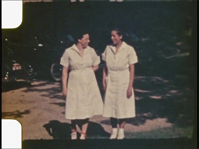 1940s: UNITED STATES: ladies look at camera. Lady laughs at camera. Ladies in uniform at camp.