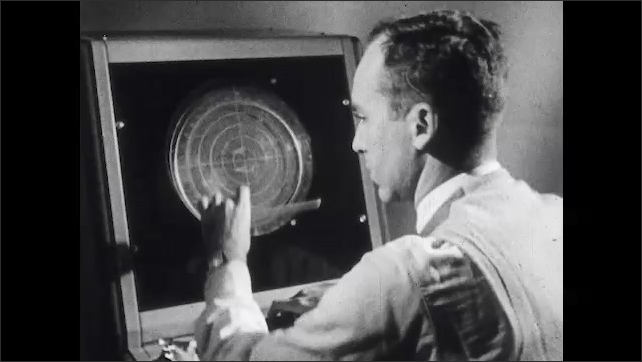 1960s: Test air controller handles the emergency of radar failure and makes notations on the screen. Engineering psychologist watches and makes notes.