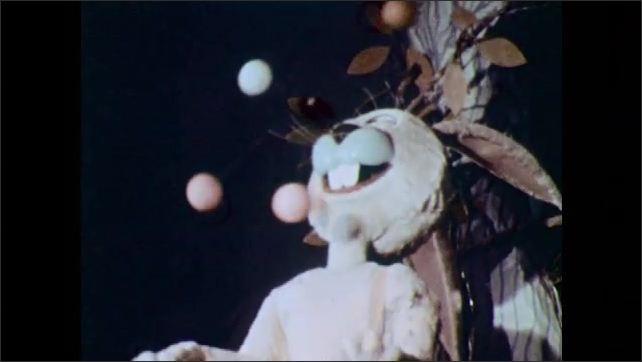 Rabbit floats in air with handful of balloons. Animatronic rabbit juggles. Animatronic watermelons open and close mouths.