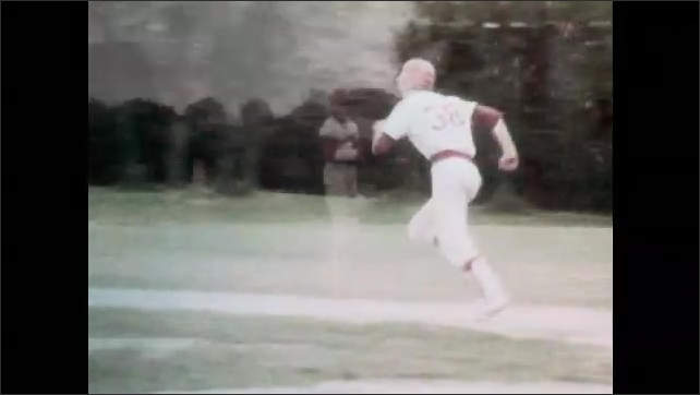 1980s: School baseball team plays. Batters swing, run to first base. Pitchers pitch.