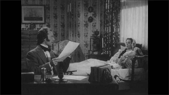 1940s: Holmes reads letter out loud. Holmes and woman laugh.