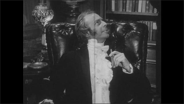 1940s: Man stands next to man in chair, talks. Man in chair talks. Man holds magazine, flips open. Man sits in chair, holds magazine, talks.