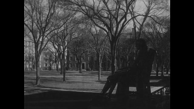 1940s: View of Harvard campus. Holmes and an older man have a conversation during breakfast.