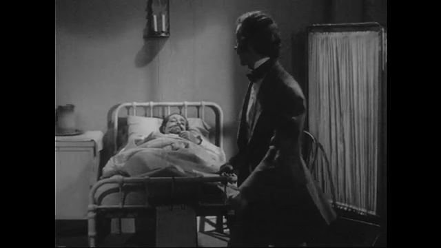 1940s: A tall man interrupts Holmes and a patient.