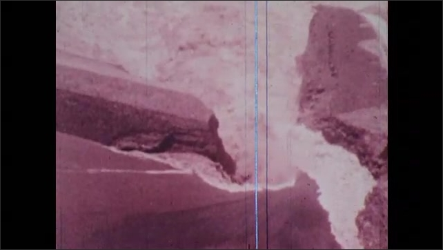 1970s: Aerial footage of the Teton Dam bursting and water pours into the Snake River.