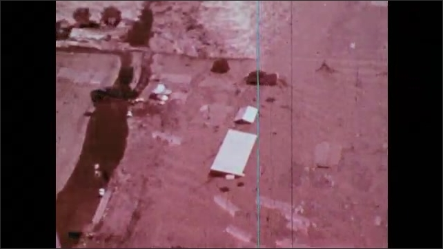1970s: Aerial footage of farmland covered in flood waters after Teton Dam burst.
