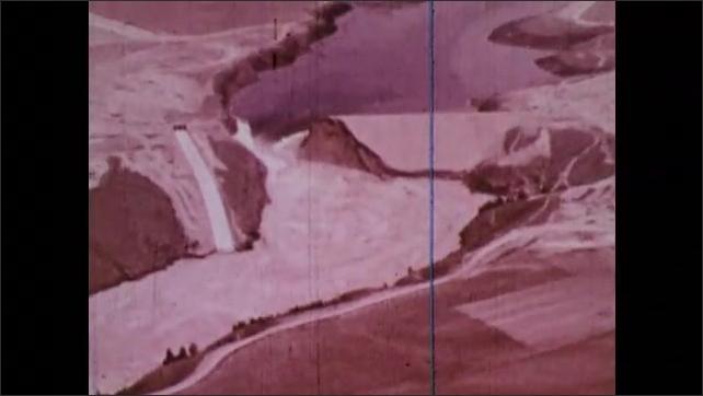 1970s: Aerial footage of unflooded Snake River plain and broken Teton Dam.