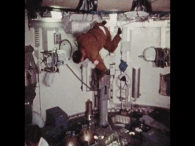 1970s: Astronauts float, flips, twist, and spin through space station.