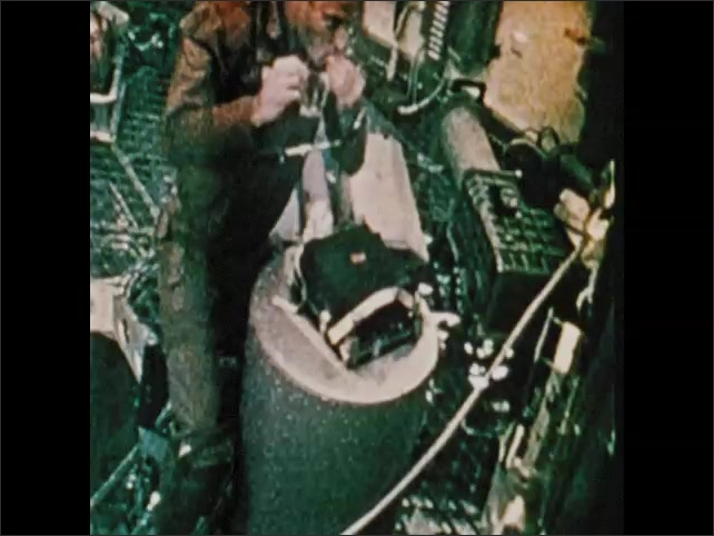1970s: Astronaut removes screws from object, sticks screws to wall. Man speaks.