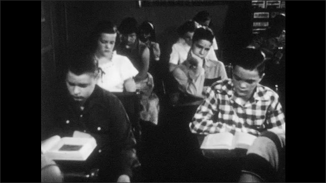 1950s: Two boys talk angrily. One boy talks and looks scared. Students sit in classroom and read, a boy looks around at another boy.