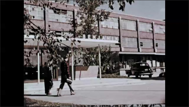 1950s: Boys talk and walk into school together. People and car move through neighborhood. Modern building. Factory, Office building, People window-shop at city store.