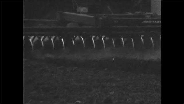 1970s: Farmland. Tractor tills the soil.