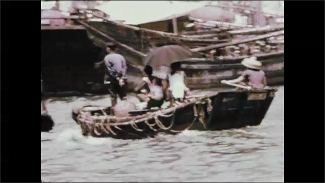 1970s: People on fishing boats.