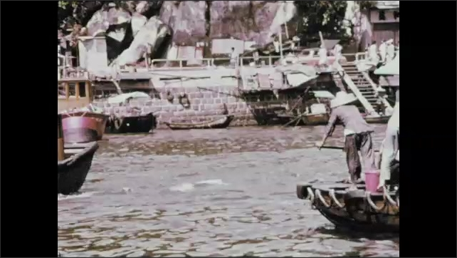 1970s: Fishing boats on water. People steer fishing boat.