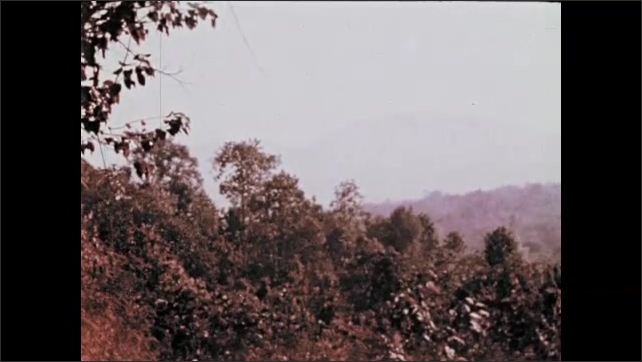 1970s: Mountains and trees.