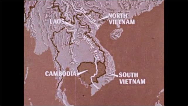 1970s: Men drive long motorboat across Mekong River. Map of Indochina. Words and arrows disappear near countries and rivers on map. Aerial view of trees, farmland and river.