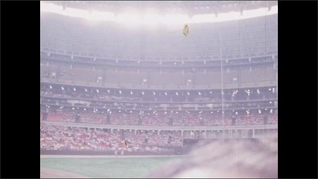 1960s: Panning shot of interior of baseball stadium.
