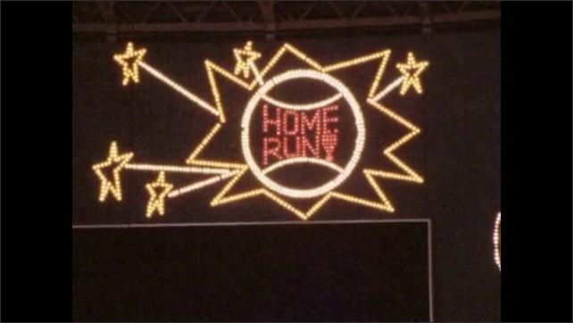 1960s: Pan across lights on scoreboard. Animated lights on scoreboard.