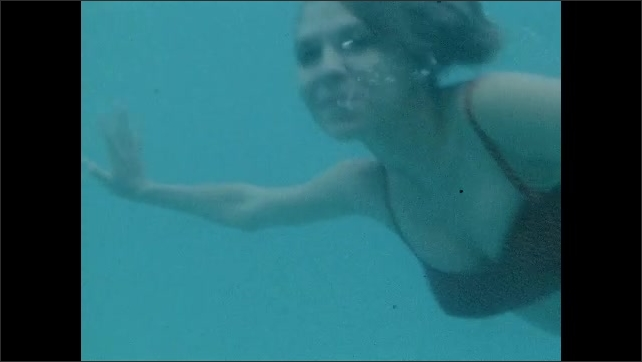 1960s: Low angle view of ceiling. Woman standing on set. Underwater shots of woman swimming.