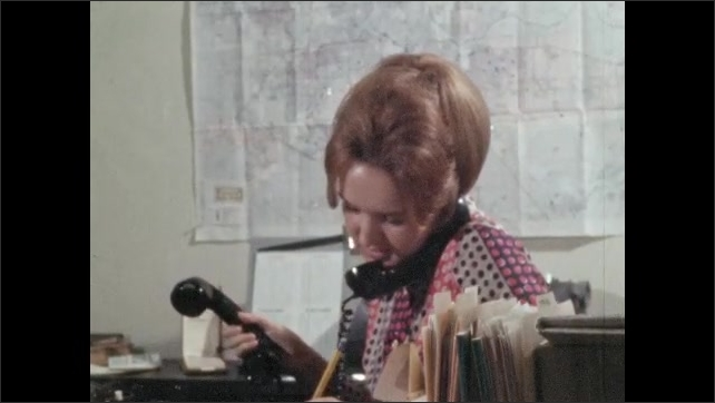1960s: Word on window, tilt down to woman talking on phones.