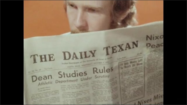 1970s: UNITED STATES: couple read The Daily Texan newspaper.