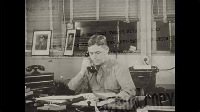 1940s: Close up of text on telegraph. Man talks on phone at desk. Close up, man talking on phone.