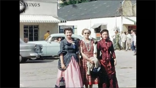 1950s: Three women in old-fashioned costumes pose for the camera.