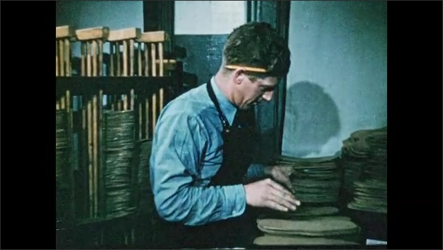 1950s: Man cuts leather with step cutter and shoe mold. Man inspects leather shoe cutouts. Man uses machine to trim leather insoles.