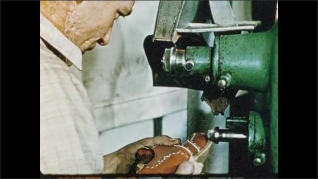 1950s: Man uses machine to nail heel base onto shoe. Man uses machine to shape and trim edges of sole.