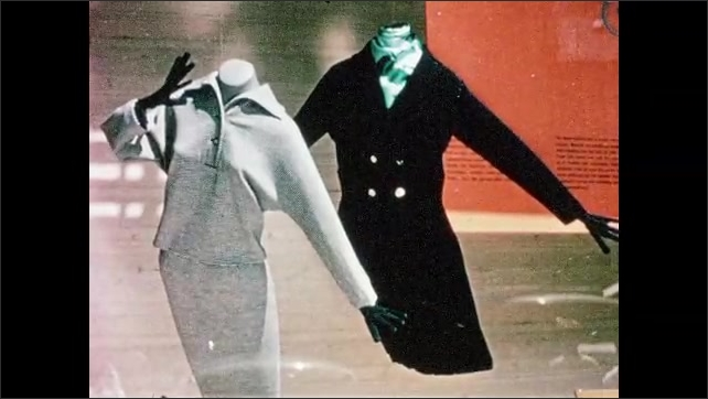 1960s: trolley cars drive around streets in downtown Zurich. feet of women stand on grate. ladies shop at Bally store. headless mannequins wear skirts and jackets. females stroll down sidewalk.