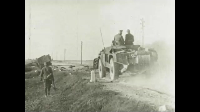 1930s: Soldiers ride through field. Bombs explode. Soldiers in jeep drive down road. People pass flowers to soldiers.