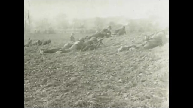 1930s: Soldiers fire large caliber guns. Soldiers lay in field. Abandoned tanks and ground guns.