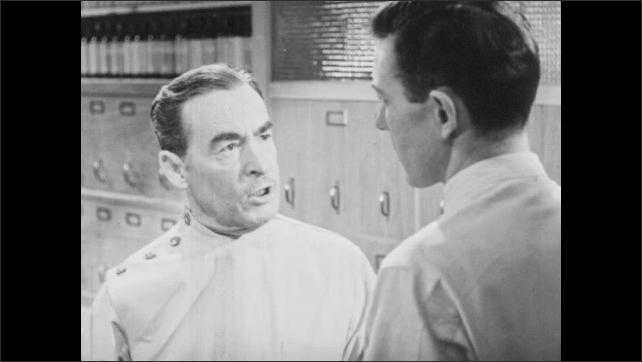 1940s: Store.  Men argue.  Man gestures.