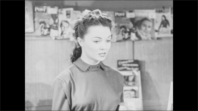 1940s: Store.  Girl looks at magazines and walks to counter.  Girl looks at product.  Woman walks past.