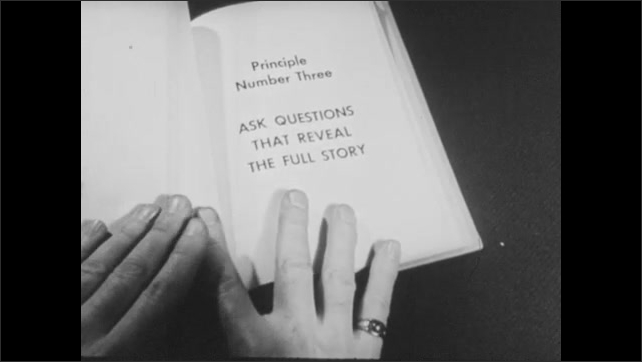 1940s: UNITED STATES: Hand turns page in book. Principal Number Two title. Treat Customers as Brand Conscious Buyers title. Ask questions title.