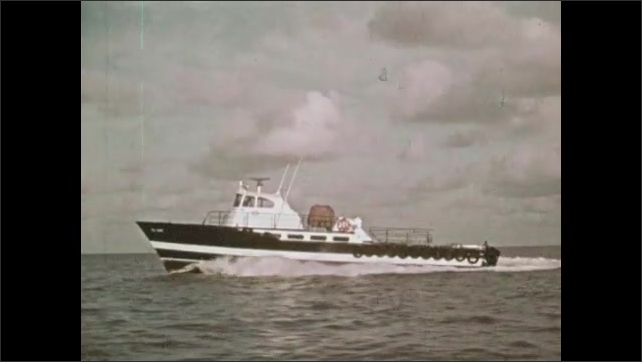 1970s: Men steer boat. Man sleeps on boat. Man cracks egg into cup. Boats speed across water.