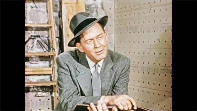 1950s: House under construction.  Salesman talks to man.
