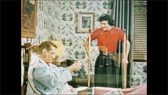 1950s: Man in hospital room.  House.  Man lays in bed and looks at check.  Young woman plays with crutches.  People speak.