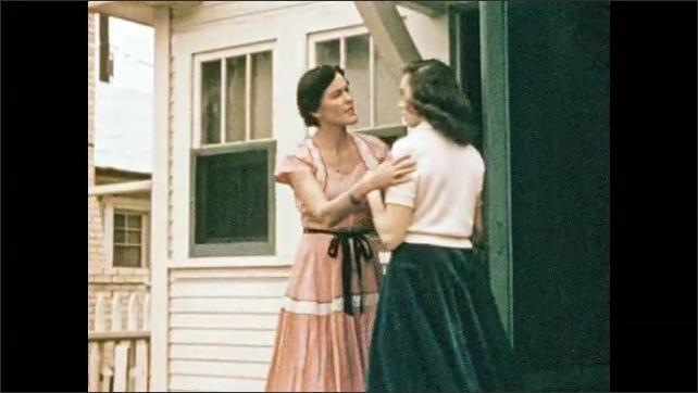 1950s: Cheerleaders.  People walk down sidewalk.  Train.  Woman meets daughter at door.  People speak.  Man lays in bed.  Girl sits.