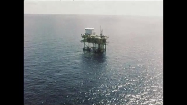 1960s: UNITED STATES: view of offshore rig from helicopter. Rig in Gulf of Mexico. Helicopter platform on rig.