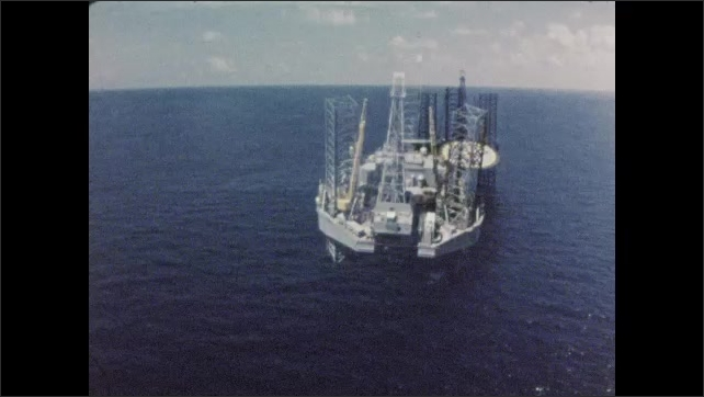 1960s: UNITED STATES: overhead view of oil rig. Self elevating oil rig. Helicopter pad on oil rig.