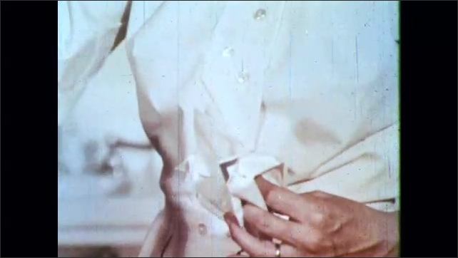 1960s: Child looks around in hospital bed. Hands remove gauze from wrapper. Nurse places gauze in pan with forceps. Women try to hold child still on hospital bed.