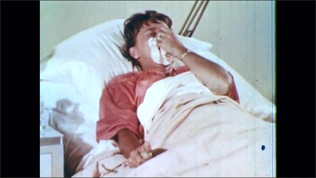 1960s: Hand presses nurse alert button repeatedly. Woman in hospital bed sobs and presses emergency button repeatedly. Patient sobs and speaks to nurse.
