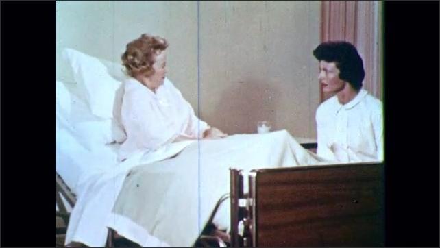 1960s: Nurse listens to woman patient and patient confesses about her nervousness.
