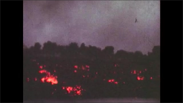 1950s: Volcano erupting. Lava flowing and cooling.
