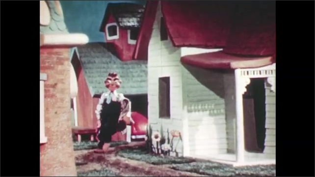 1950s: Marionette puppets drive down street of model town. Woman puppet exits house, walks down street. Man puppet walks down street, holds jacket, waves to dog puppet.