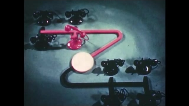 1950s: Toy telephones sit on table as part of a diagram. Animation changes telephone and connecting line colors from red to black to demonstrate function of party line.